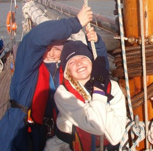 Voyage crew hoist a sail